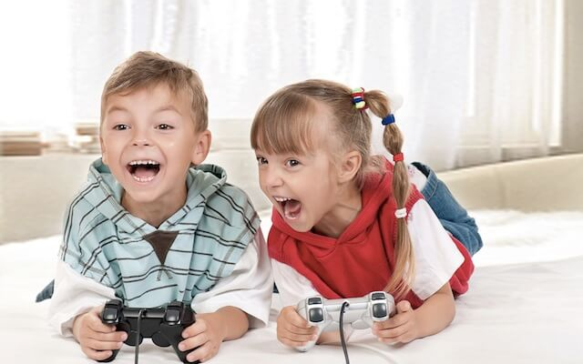 Kids playing video games at sleepover