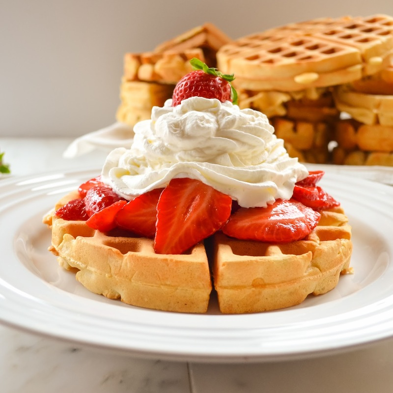 Whole Grain Waffles with Strawberries and Whipped Cream